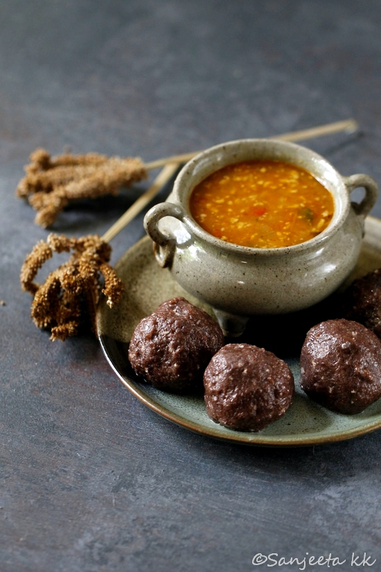 Finger Millet Dumplings with spicy tomato curry